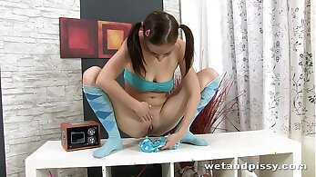 Black-haired cutie with pigtails is peeing in the car