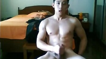Chinese twink jerk a penis